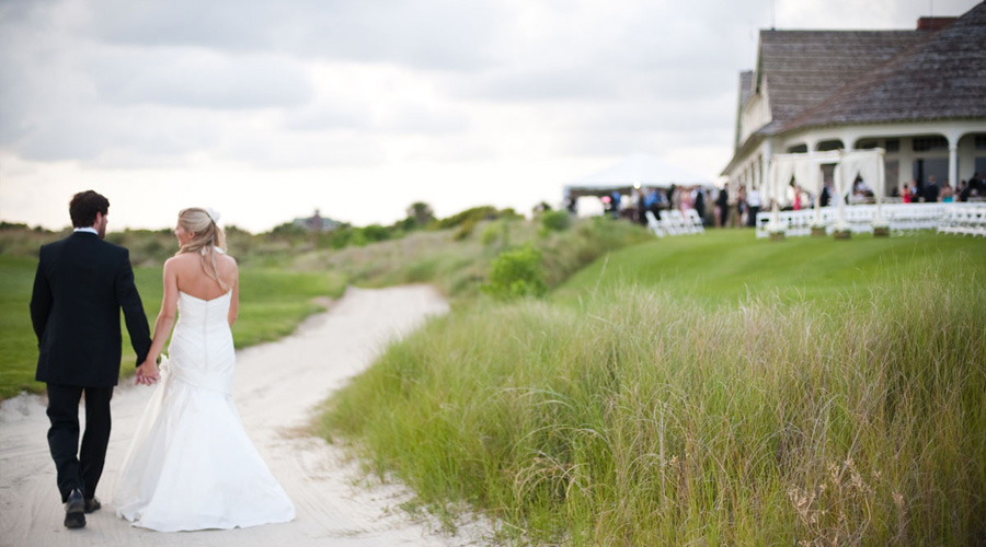 Wedding couple walk path at the ocean course clubhouse