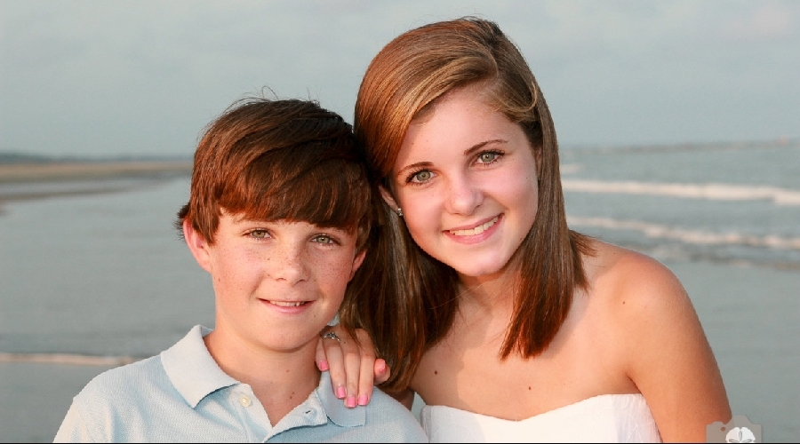 Sister and brother pose for photo on beach at kiawah island by photo graphics