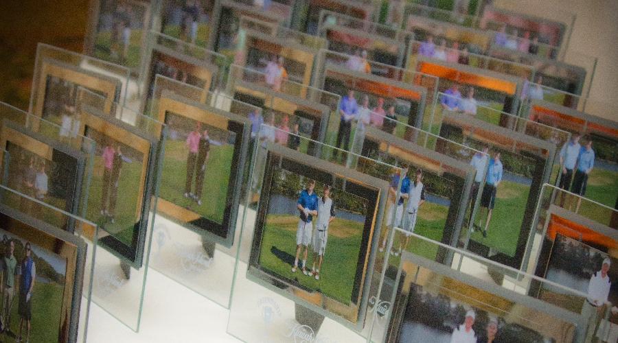Course play in photo frames displayed at 2012 friendship cup awards dinner