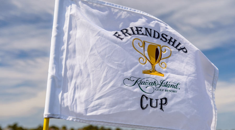 Friendship cup flags wave in the wind on the golf courses.