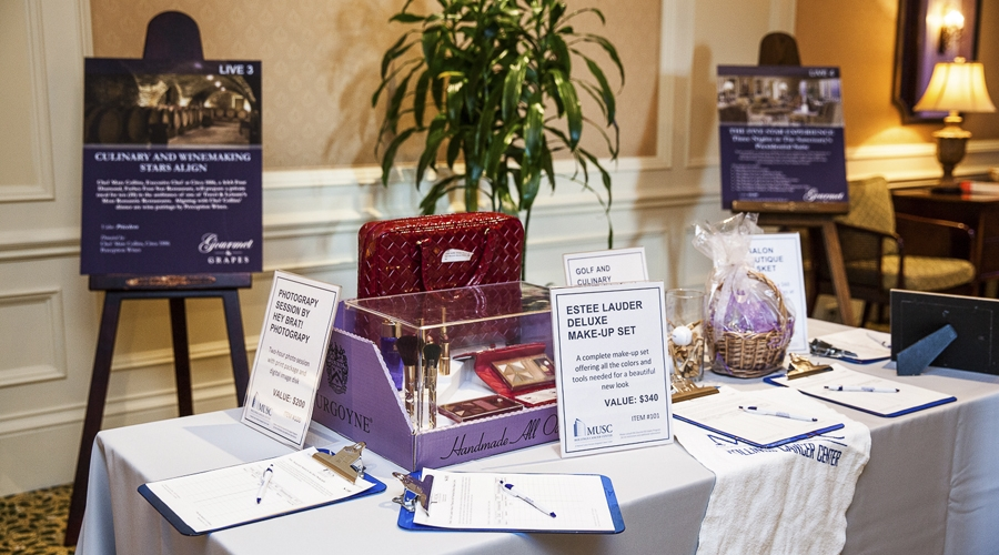 Silent auction items on display for annual gourmet and grapes weekend