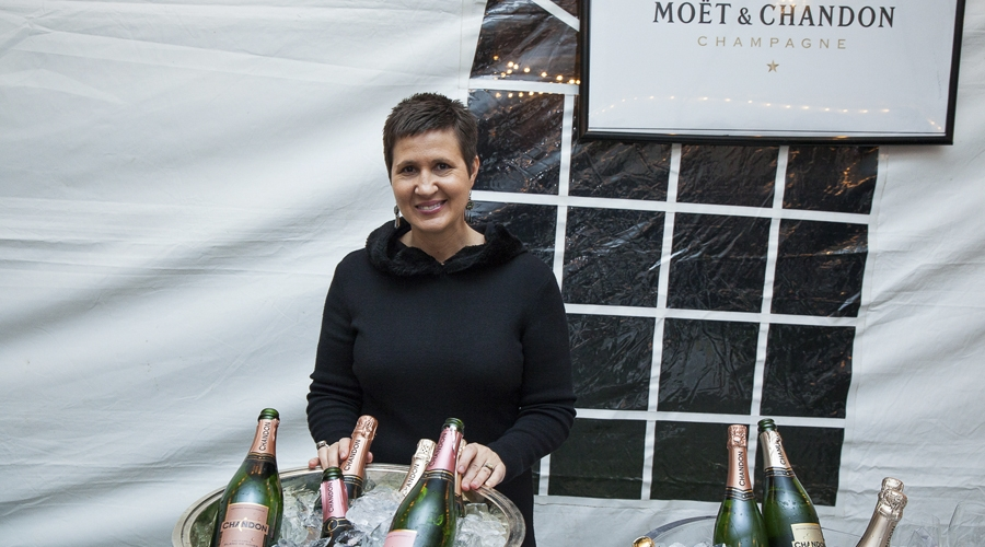 Moet & chandon rep poses with bottles on ice