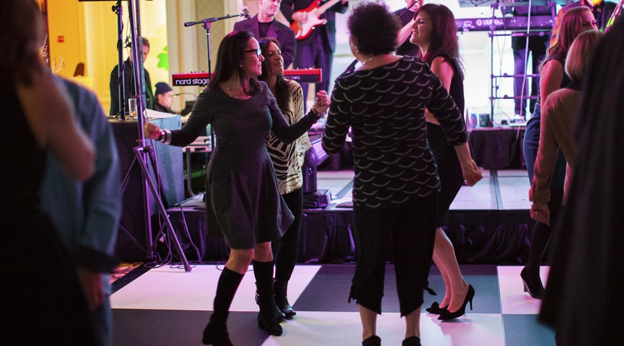 attendees dancing at annual gourmet and grapes