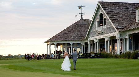 Outdoor wedding ceremony on the green at the ocean course
