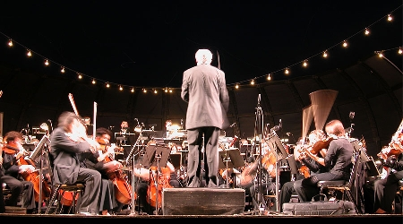 Conductor leads orchestra at charleston, sc symphony
