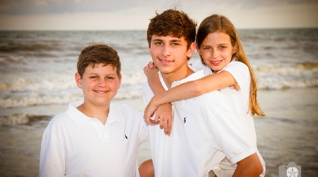 Children pose for photo on beach at kiawah island by photographics
