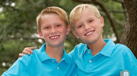 Young brothers pose for photo at kiawah island by photographics