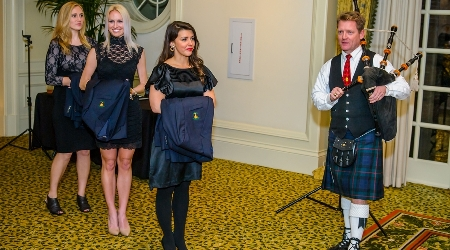 Bagpipe player during jacket presentation