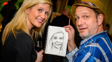 Artist displays drawing of guest.