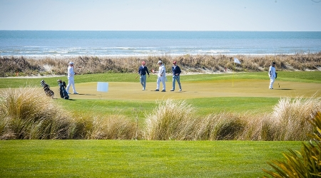 Golfers on the front nine of the ocean course