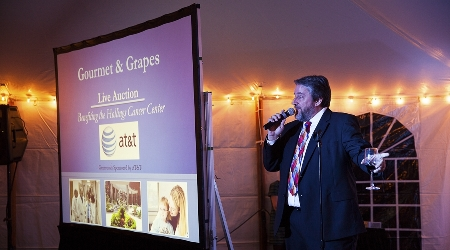 Richard Todd MCs the annual gourmet and grapes live auction