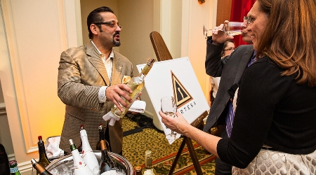 Vintner pours wine for guests