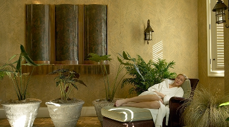Woman relaxes in spa solarium