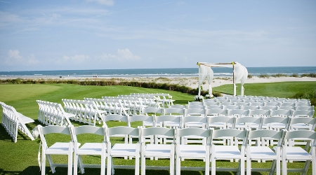 Wedding ceremony set up on the 18th green at the ocean course