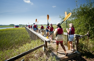 Group prepares for a kayak trip at kiawah island golf resort