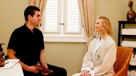 Guest receives consultation before spa treatment