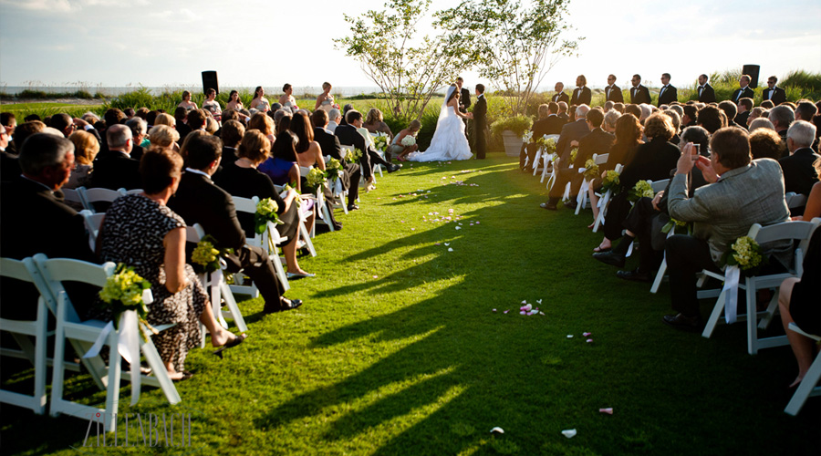 Couple in wedding ceremony at ocean course clubhouse kiawah island