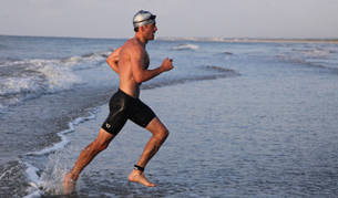 man swimming during triathlon