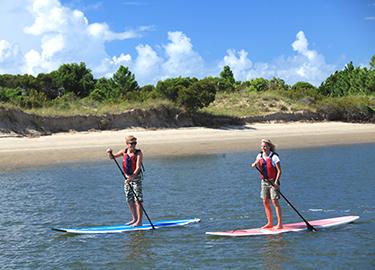 teen paddleboarding
