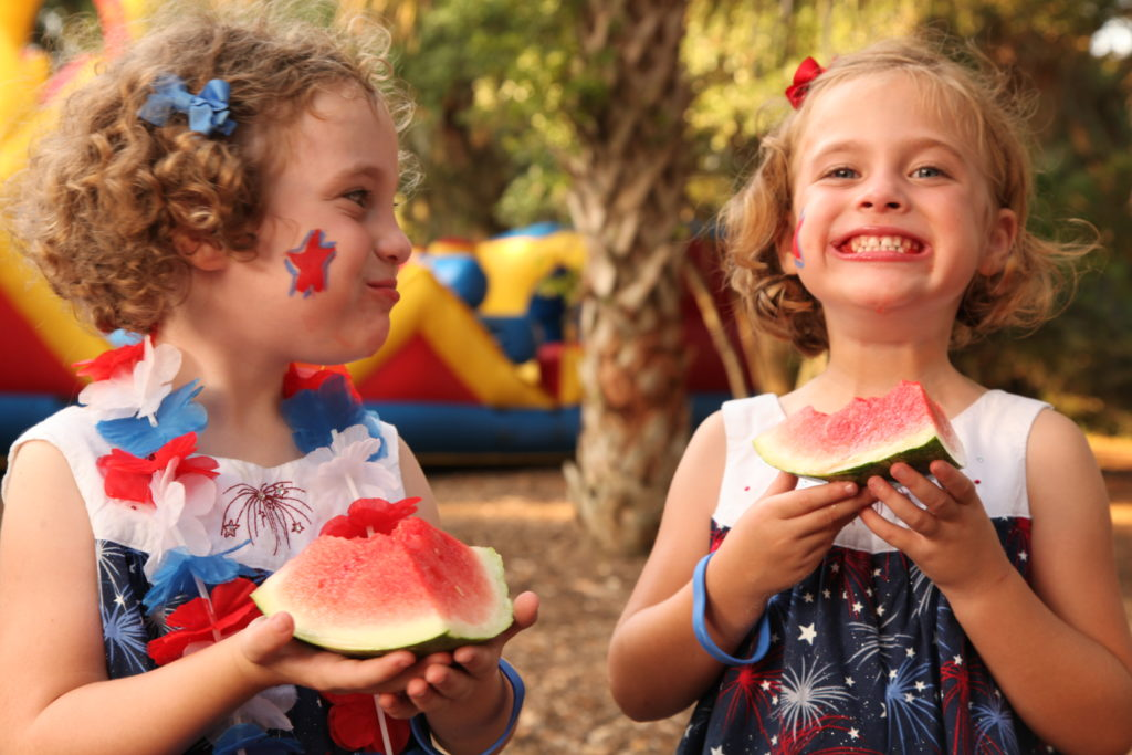 Girls eat watermelon on the Fourth of July at Kiawah